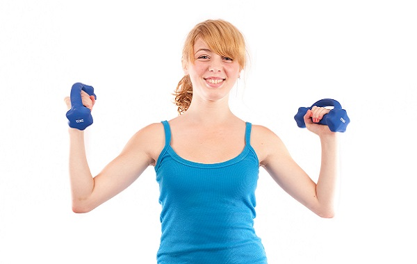 Blonde girl doing fitness, isolated on white
