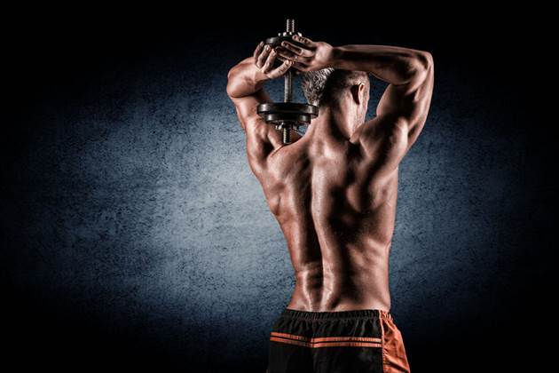 43856245 - strong and handsome young man doing exercise with dumbbells