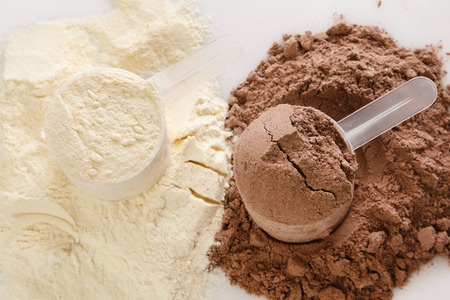34971327 - close up of protein powder and scoops
