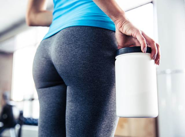 38584259 - closeup image of female body with sports nutrition at gym