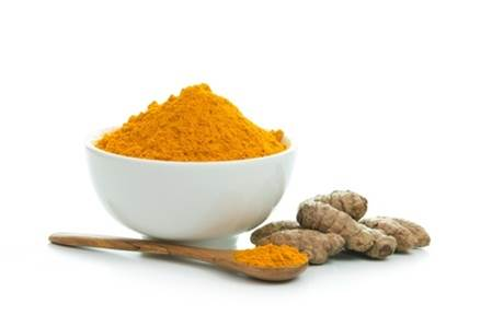19576037 - bowl of turmeric powder with fresh turmeric root