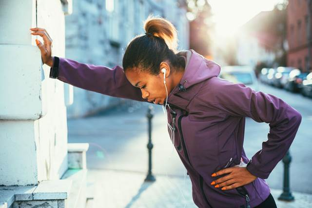 31455218 - tired young woman cathing her breath after a long run