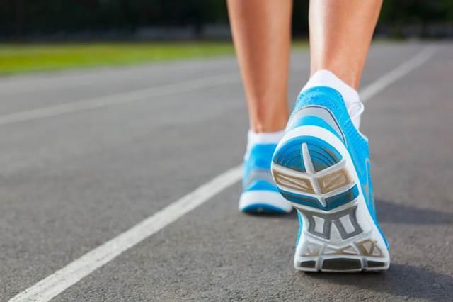 21695660 - runner feet running on stadium closeup -outdoor shot