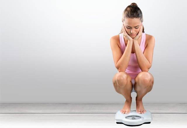 43125825 - dieting, women, weight scale.